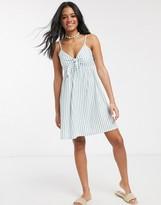 Asos Design DESIGN cami bow front mini sundress in sage and white stripe