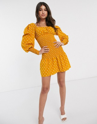 Parisian polka dot shirred waist puff sleeve mini dress in mustard