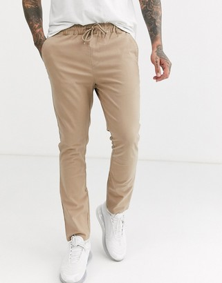 Asos DESIGN skinny chinos with elastic waist in stone