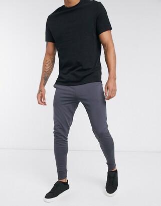 ASOS DESIGN lightweight skinny joggers in washed black