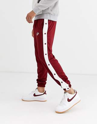 Nike Heritage popper joggers in red