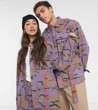 Collusion Unisex utility jacket in camo with typo taping