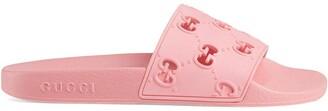 Gucci rubber GG slide sandals