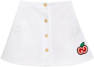 Gucci Cotton mini skirt with GG apple