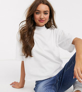 Asos DESIGN Petite boxy crop t-shirt with high neck in white