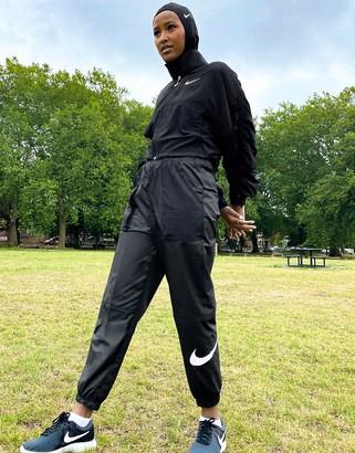 Nike woven swoosh cargo pants with belt in black