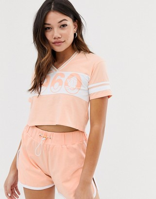 Lonsdale London cropped varsity v neck t-shirt in peach