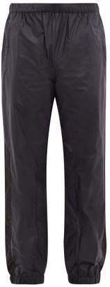 Acne Studios Pegasus Side-stripe Technical Ripstop Track Pants - Mens - Navy