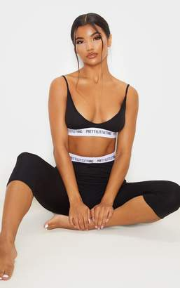 PrettyLittleThing Black Bralet And Crop Legging PJ Set
