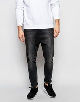 Asos Drop Crotch Jeans With Rip And Repair In Washed Black
