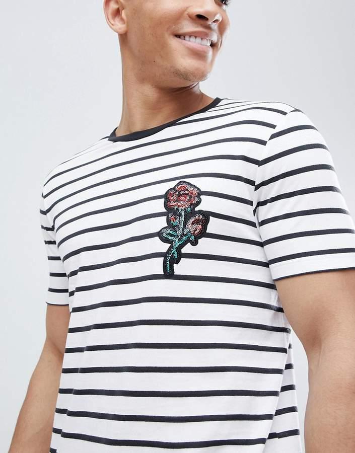 Asos Design DESIGN stripe t-shirt with sequin floral chest applique