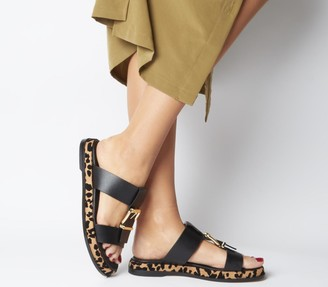 Office Stunner Buckle Strap Mule Sandals Black Leather Leopard Sole