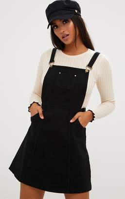 PrettyLittleThing Martine Black Denim Pinafore Dress