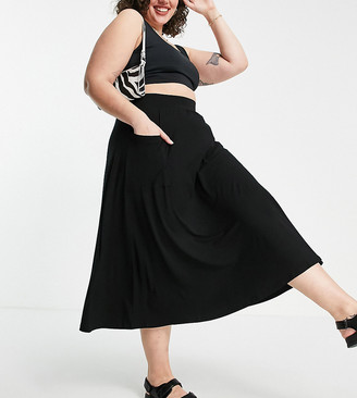 ASOS DESIGN Curve midi skirt with pockets in black