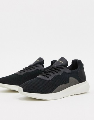 Bershka runner sneaker in black with contrast sole