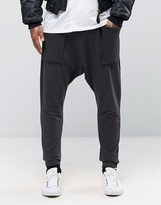 Asos Drop Crotch Joggers With Waffle Pockets In Washed Black