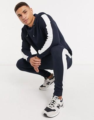 ASOS DESIGN tracksuit with hoodie & side stripe in navy