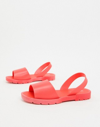 ASOS DESIGN Finale jelly flat sandals in coral