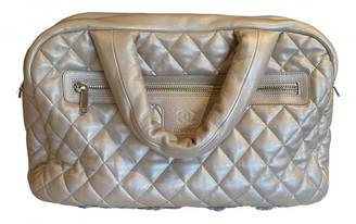 Chanel Coco Cocoon Gold Leather Travel bags