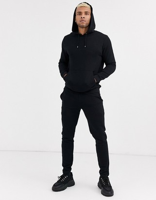 Asos Design DESIGN tracksuit with hoodie & fixed hem joggers in black