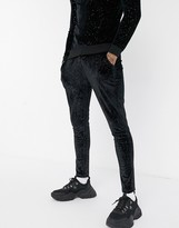 Asos Design DESIGN co-ord super skinny joggers in velour with fixed hem in black with silver flecks
