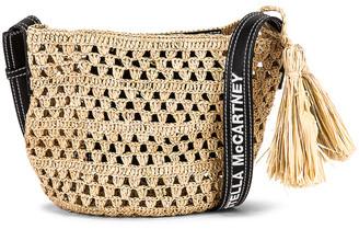 Stella McCartney Ajouree Raffia Crochet Bucket Bag in Light Sand | FWRD