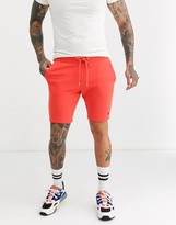 Asos DESIGN jersey skinny shorts in coral with triangle