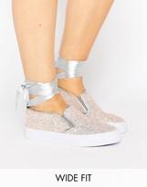 Asos DESIRE Wide Fit Tie Leg Sneakers