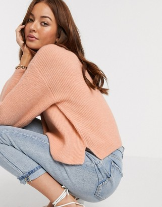 Asos Design DESIGN fluffy v neck ribbed jumper with balloon sleeve in recycled blend-Pink