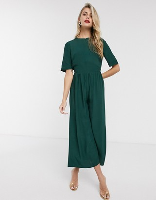 ASOS DESIGN tea jumpsuit with button back detail in forest green