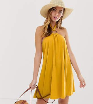 Asos DESIGN Petite mini halter swing dress with faux tortoiseshell ring detail