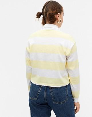 Monki organic cotton striped polo shirt in yellow