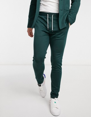 ASOS DESIGN super skinny soft tailored sweatpants in jersey in bottle green