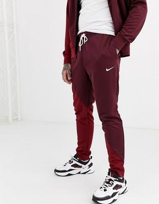 Nike Swoosh cuffed joggers in burgundy/red