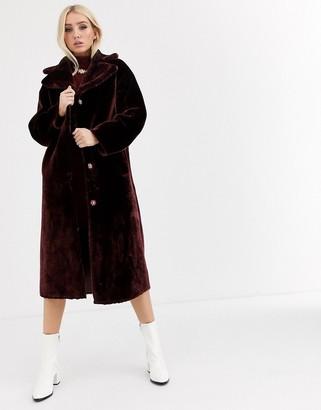 ASOS DESIGN plush faux fur maxi coat in burgundy