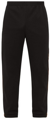 Gucci Logo-embroidered Swiss-dot Jersey Track Pants - Mens - Black