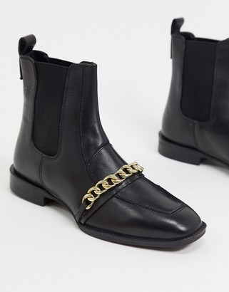 ASOS DESIGN Ava leather loafer boot with chain trim in black