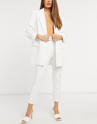 ELVI belted cigarette pants in white