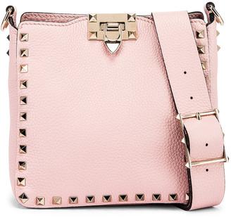 Valentino Rockstud Messenger Bag in Water Rose | FWRD