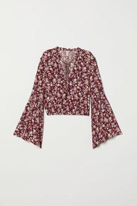 H&M Trumpet-sleeved blouse