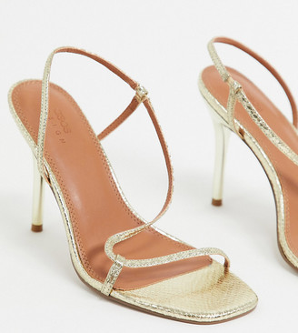ASOS DESIGN Wide Fit Nevada strappy heeled sandals in gold snake