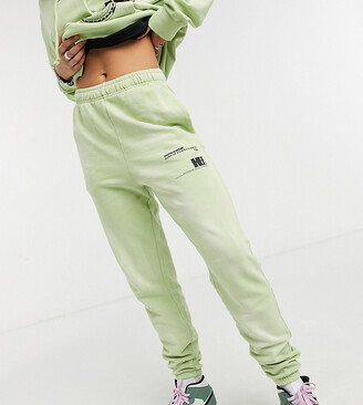 Collusion text print bleached wash skinny trackies co-ord in green