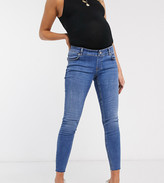 Asos DESIGN Maternity Ridley high waisted skinny jeans in mid wash blue with over the bump band