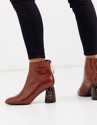 Glamorous brown patent boots with leopard heel