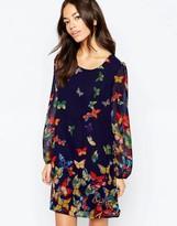 Yumi Long Sleeve Shift Dress in Butterfly Border Print