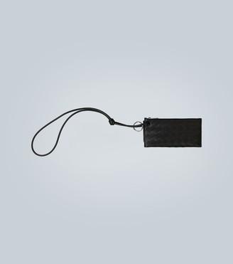 Bottega Veneta Leather travel wallet with strap