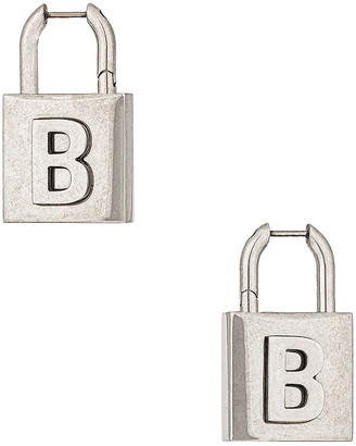 Balenciaga Lock Earrings in Antique Silver | FWRD