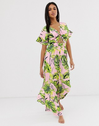 Asos Design DESIGN wide leg beach jumpsuit with cut out waist & ring detail in pink palm print