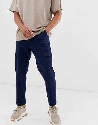 Asos Design DESIGN tapered cargo trousers with toggles in navy