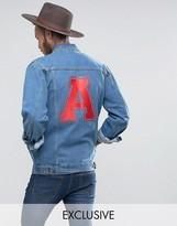 Reclaimed Vintage Inspired Oversized Denim Jacket With Varsity Back Print